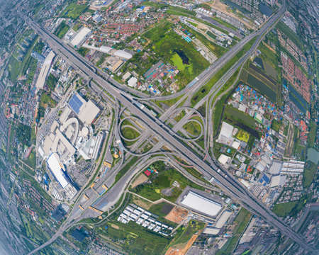 Aerial view of cars driving on highway junctions. Bridge street roads in connection network of architecture concept. Top view. Urban city, Bangkok, Thailand.