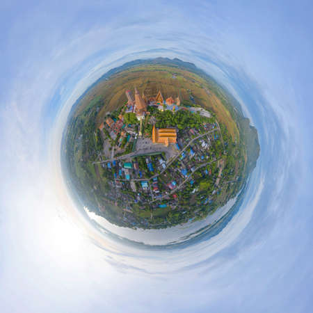 Little planet 360 degree sphere. Panorama of aerial view of Big Golden Buddha Statue and pagoda in Tiger Cave Temple or Wat Tham Suea in Kanchanaburi, Thailand. Famous tourist attraction. Banco de Imagens - 158827473