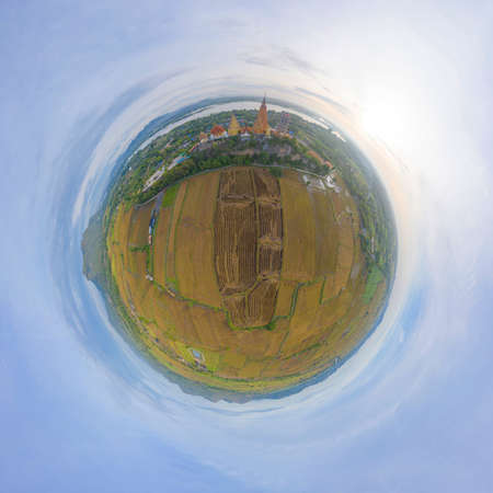 Little planet 360 degree sphere. Panorama of aerial view of Big Golden Buddha Statue and pagoda in Tiger Cave Temple or Wat Tham Suea in Kanchanaburi, Thailand. Famous tourist attraction.