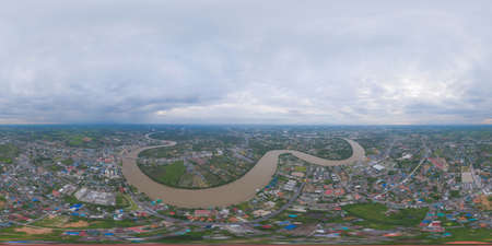 360 panorama by 180 degrees angle seamless panorama of aerial view of buildings with curve of Chao Phraya River. Cha Choeng Sao skyline near Bangkok, Urban city in downtown area at sunset, Thailand.