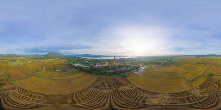 360 panorama by 180 degrees angle seamless panorama of aerial view of Big Golden Buddha Statue and pagoda in Tiger Cave Temple or Wat Tham Suea in Kanchanaburi, Thailand. Famous tourist attraction.