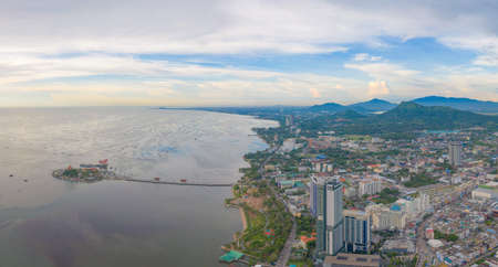 Aerial view of residential buildings in Sri Racha district with sea, Chonburi skyline, Thailand. Urban city in Asia. Architecture landscape background. Banco de Imagens