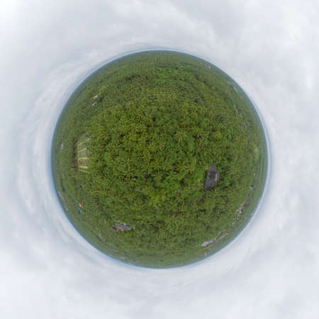 Little planet 360 degree sphere. Panorama of aerial view of coconut or palm trees. Nature landscape forest background in agriculture farm concept, Ratchaburi, Thailand. Food crops.