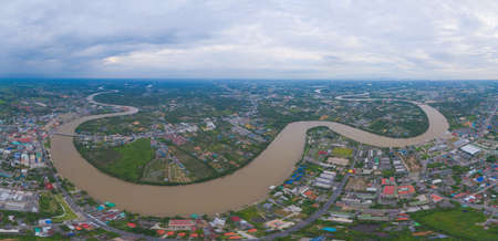 Aerial view of buildings with curve of Chao Phraya River. Cha Choeng Sao skyline near Bangkok, Urban city in downtown area at sunset, Thailand. Imagens
