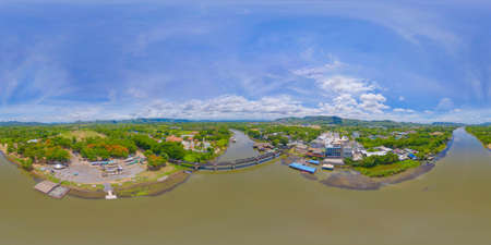 360 panorama by 180 degrees angle seamless panorama of aerial view of River Kwai Bridge with train rail way with Chao Phraya River, Tha Ma Kham, Mueang Kanchanaburi District, Thailand.