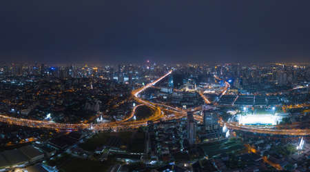 Aerial view of cars driving on highway junctions. Bridge street roads in connection network of architecture concept. Top view. Urban city, Bangkok at night, Thailand. Editorial
