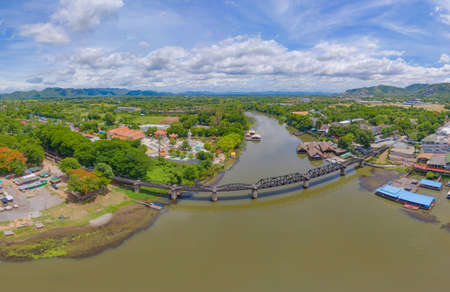 Aerial view of River Kwai Bridge with train rail way with Chao Phraya River, Tha Ma Kham, Mueang Kanchanaburi District, Thailand. Editorial