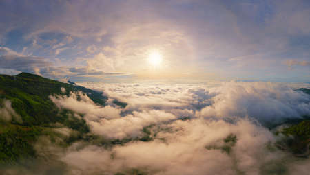 Aerial view of sunrise above fluffy sea fog misty clouds with mountain hill from Phu Tub Berk, Khao Kho, Phetchabun with sunlight. Abstract nature landscape background in morning time.