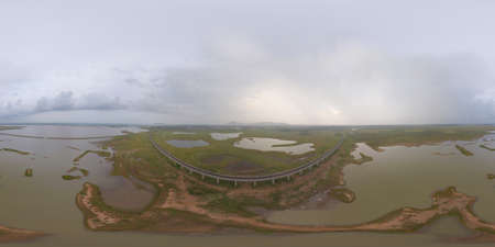 360 panorama by 180 degrees angle seamless panorama of aerial view of Thai local train on railway bridge at Pa Sak Jolasid Dam, the biggest reservoir in central Thailand, in Lopburi province. Imagens