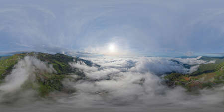 360 panorama by 180 degrees angle seamless panorama of aerial view of sunrise above fluffy sea fog misty clouds with mountain hill from Phu Tub Berk, Khao Kho, Phetchabun with sunlight. Nature