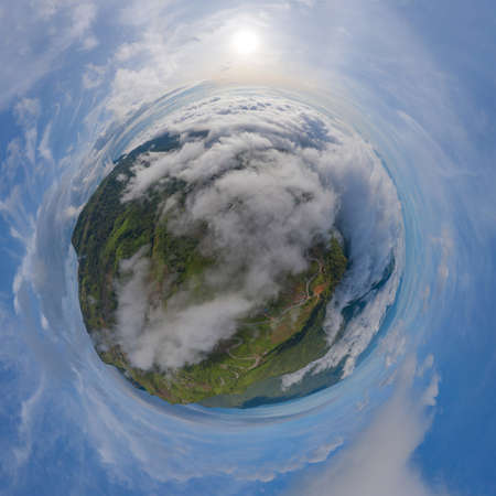 Little planet 360 degree sphere. Panorama of aerial view of sunrise above fluffy sea fog misty clouds with mountain hill from Phu Tub Berk, Khao Kho, Phetchabun with sunlight. Nature landscape Imagens