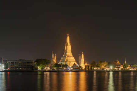 Temple of Dawn or Wat Arun with Chao Phraya River, Bangkok, Thailand in Rattanakosin Island in architecture, Urban old town city, skyline. downtown area at night.