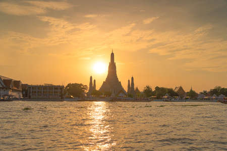 Temple of Dawn or Wat Arun with Chao Phraya River, Bangkok, Thailand in Rattanakosin Island in architecture, Urban old town city, skyline. downtown area at sunset. Editorial