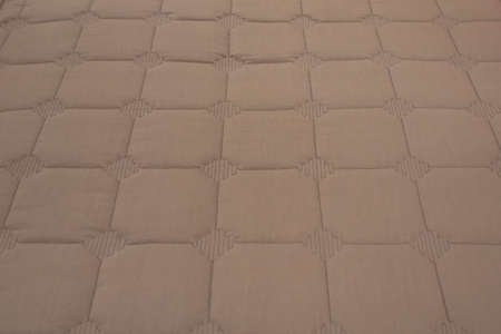 Modern beige carpet fabric flooring pattern surface texture in office. Close-up of interior material for design decoration background