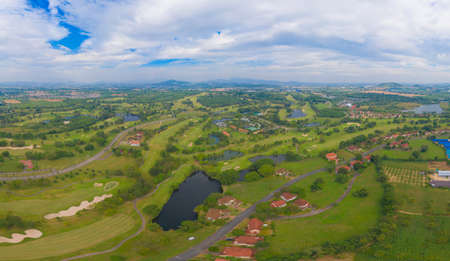 Aerial view of Golf Course Club and hotel resort. Green natural garden park in sport and recreation concept.