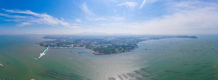 Aerial view of aquaculture nets for fish farm in a lake in Sri Racha, Chonburi, Thailand. tropical beach, Andaman sea, bay island. Top view.