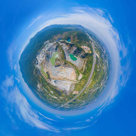 Little planet 360 degree sphere. Panorama of aerial view of machine excavator trucks dig coal mining or ore in quarry in factory industry. Environment resources. Banco de Imagens