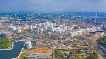 Aerial view of petrochemical oil refinery and sea in industrial engineering concept in Laem Chabang, Chonburi province, Thailand. Oil and gas tanks industry. Modern factory.