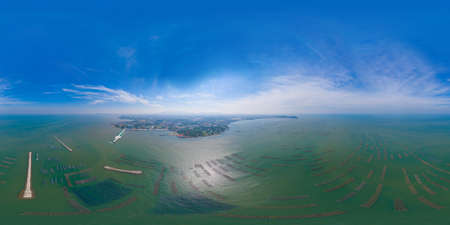 360 panorama by 180 degrees angle seamless panorama of aerial view of aquaculture nets for fish farm in a lake in Sri Racha, Chonburi, Thailand. tropical beach, Andaman sea, bay island. Top view. Banco de Imagens