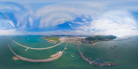 360 panorama by 180 degrees angle seamless panorama of aerial view of pier with boats with container cargo ship in the export and import business and logistics in ocean sea. Shipping to the harbour. Banco de Imagens