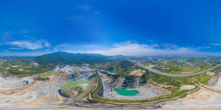 360 panorama by 180 degrees angle seamless panorama of aerial view of machine excavator trucks dig coal mining or ore in quarry in factory industry. Environment resources.