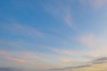 Sunset sky. Abstract nature background. Dramatic blue with orange colorful clouds in twilight time. Banco de Imagens