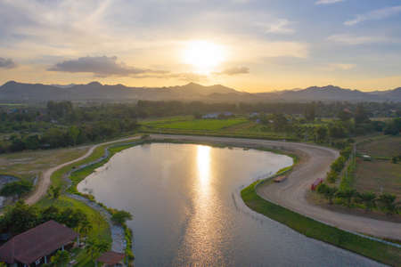 Aerial view of green mountain hill with lake or river. Nature landscape background in Khao Yai, Nakhon Ratchasima, Thailand. Banco de Imagens