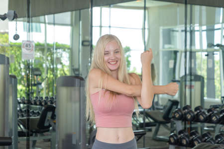 Portrait of fit white healthy woman, caucasian person, doing exercise, working out, and training in gym or fitness center in sport and recreation concept. Lifestyle activity. Banco de Imagens - 161324733