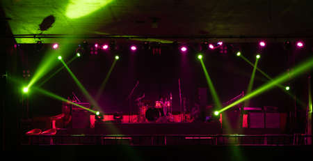 Empty stage concert with colorful lighting laser beam spotlight show in disco pub club bar background for party music dancing festival performance. Entertainment nightlife. Celebration event. Banco de Imagens - 163162087