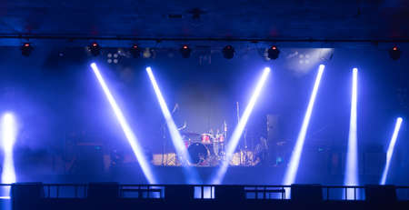 Empty stage concert with colorful lighting laser beam spotlight show in disco pub club bar background for party music dancing festival performance. Entertainment nightlife. Celebration event. Banco de Imagens - 163162089
