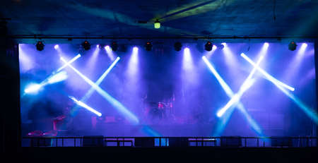Empty stage concert with colorful lighting laser beam spotlight show in disco pub club bar background for party music dancing festival performance. Entertainment nightlife. Celebration event.