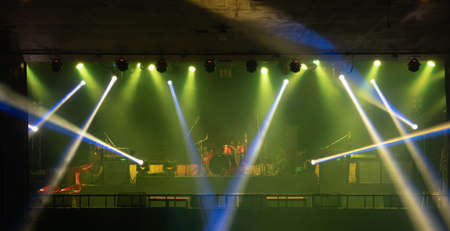 Empty stage concert with colorful lighting laser beam spotlight show in disco pub club bar background for party music dancing festival performance. Entertainment nightlife. Celebration event. Banco de Imagens - 163162113