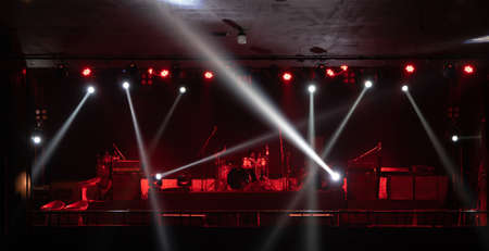 Empty stage concert with colorful lighting laser beam spotlight show in disco pub club bar background for party music dancing festival performance. Entertainment nightlife. Celebration event. Banco de Imagens - 163162114