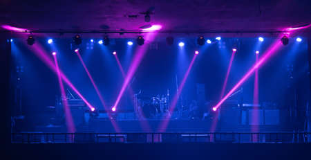 Empty stage concert with colorful lighting laser beam spotlight show in disco pub club bar background for party music dancing festival performance. Entertainment nightlife. Celebration event. Banco de Imagens - 163162117