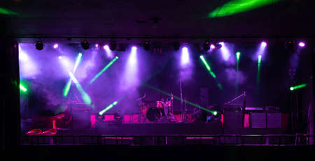 Empty stage concert with colorful lighting laser beam spotlight show in disco pub club bar background for party music dancing festival performance. Entertainment nightlife. Celebration event. Banco de Imagens - 163162118