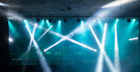 Empty stage concert with colorful lighting laser beam spotlight show in disco pub club bar background for party music dancing festival performance. Entertainment nightlife. Celebration event. Banco de Imagens - 163162125