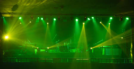 Empty stage concert with colorful lighting laser beam spotlight show in disco pub club bar background for party music dancing festival performance. Entertainment nightlife. Celebration event. Banco de Imagens - 163162128