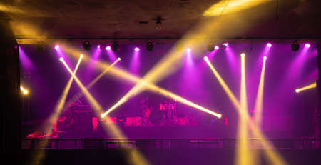 Empty stage concert with colorful lighting laser beam spotlight show in disco pub club bar background for party music dancing festival performance. Entertainment nightlife. Celebration event. Banco de Imagens - 163162131