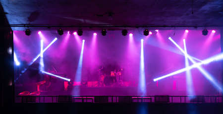 Empty stage concert with colorful lighting laser beam spotlight show in disco pub club bar background for party music dancing festival performance. Entertainment nightlife. Celebration event. Banco de Imagens - 163162132
