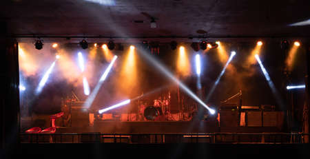 Empty stage concert with colorful lighting laser beam spotlight show in disco pub club bar background for party music dancing festival performance. Entertainment nightlife. Celebration event. Banco de Imagens - 163162135