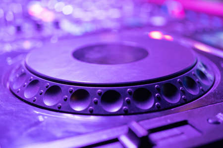Mixes on CD players or track at nightclub during party for DJ. Nightlife of disco club in disco pub club bar background for party music dancing festival performance. Entertainment nightlife.