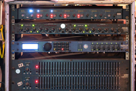 Network server of concert audio sound signal boardcast production studio panel in technology concept. Switch and patch cord cables in control data room.