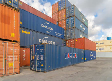 Shipping container site loading by crane in logistic port warehouse storage factory manufacturing business transportation import and export goods of freight business carrier. Banco de Imagens - 163424376