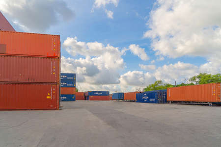 Shipping container site loading by crane in logistic port warehouse storage factory manufacturing business transportation import and export goods of freight business carrier. Banco de Imagens - 163424055