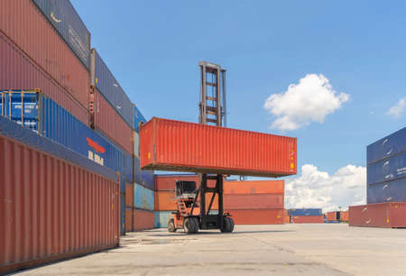 Shipping container site loading by crane in logistic port warehouse storage factory manufacturing business transportation import and export goods of freight business carrier. Banco de Imagens - 163424674