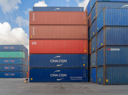 Shipping container site loading by crane in logistic port warehouse storage factory manufacturing business transportation import and export goods of freight business carrier. Banco de Imagens - 163424262