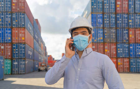 Sick middle east logistic worker engineer man working in cargo container,wearing a face mask in warehouse industry factory site. Export, import concept. Business people. Corona virus and health care.