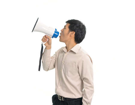 Portrait of young Asian businessman holding speaking over a megaphone or speaker, loudness testing isolated on white background Stock Photo