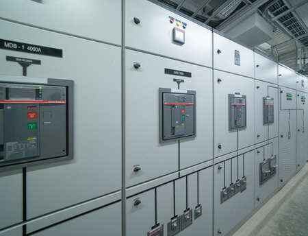 Interior of electrical room. Power energy motor machinery cabinets in control or server room, main operator station network and circuit center in industry factory manufacturing system. generator