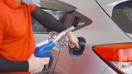 Close up of car fueling process at gasoline petrol station, refuel petroleum oil and energy vehicle business service in transportation concept. Job work. Stock Photo
